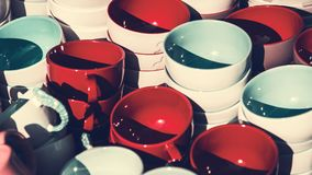 Various colorful ceramic bowls and cups Stock Images