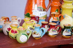 Various colorful clay handmade jug jar sell market Stock Photo