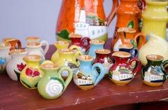 Various colorful clay handmade jug jar sell market Stock Photo