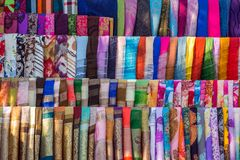 Various of colorful fabrics and shawls Stock Photos