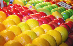 Various Colorful Fresh Fruits On Market Stand Stock Photography