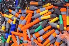 Garden hose nozzles. Various colorful garden hose nozzles sprayer parts stock photo