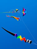 Various Colorful Kites Flying Stock Photography