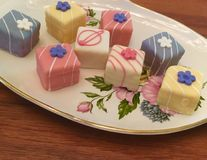 Colorful plate of petit fours royalty free stock image