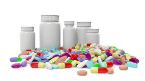 Various colorful pills with bottles Stock Images