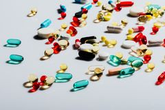 Various colorful pills. Close-up view of various colorful pills on grey Stock Photography
