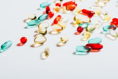 Various colorful pills. Close-up view of various colorful pills and tablets on grey Royalty Free Stock Images