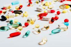 Various colorful pills. Close-up view of various colorful medical pills on grey Stock Images