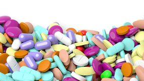 Various colorful pills in a pile with copy-space. Isolated on white background Stock Photography