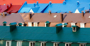 Various colorful roofs. Row of many multicolored roofs. Top view Stock Photography
