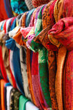 Various colorful scarves hanging at street bazaar Stock Images