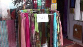 Various colorful shawls in market, India. Various colorful shawls in street market, India stock video
