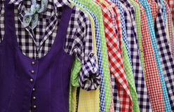 Various colorful shirts. Various colorful hanging chequer shirts royalty free stock photo