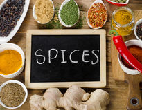 Various colorful spices on a wooden board Stock Photo