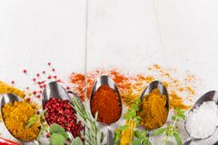 Various colorful spices on wooden table Royalty Free Stock Images