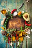Various colorful spices on wooden table Stock Photography