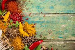 Various colorful spices on wooden table Stock Images