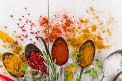 Various colorful spices on wooden table Stock Photos