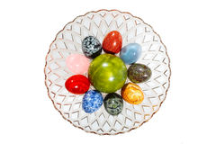 Various colorful stone eggs in the vase Stock Image