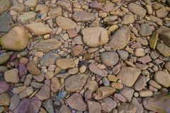 Colorful stones laying on beach royalty free stock photo