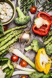 Various colorful vegetables ingredients with cooking spoon and feta cheese for tasty cooking, top view. Healthy vegetarian food Stock Image