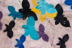 The various colors of the butterfly are painted on the wall by flying and carefree. royalty free stock photos