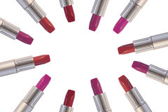 Various colors of lipsticks. Isolated on white Royalty Free Stock Photo