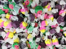 Various colors of salt water taffy royalty free stock image