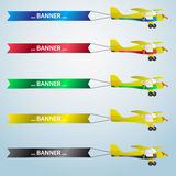 Various colors vector small airplane with banner Royalty Free Stock Photo