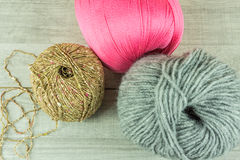 Various colors Wool balls in a wooden box with knitting needles Royalty Free Stock Photo