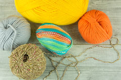 Various colors Wool balls in a wooden box with knitting needles Stock Images