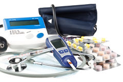 Various colour pills and medical tools Stock Photography