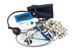 Various colour pills and medical tools Royalty Free Stock Photography