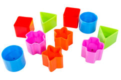 Various coloured blocks for shape sorter toy isolated. On white background royalty free stock photo