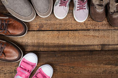 Various colourful footwear. On the wooden background royalty free stock photography