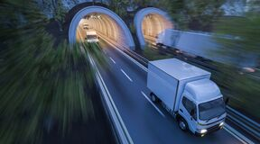 Free Various Commercial Vehicles Moving Through Tunnels Royalty Free Stock Photography - 185970267