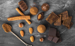 Various confectionery: chocolate, candies on a dark background Stock Photo