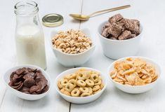 Various conrflake cereals in bowls and milk Stock Image