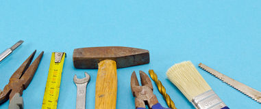 Various construction work tools on blue Stock Photo