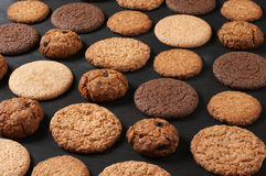 Various cookies on black Royalty Free Stock Photos