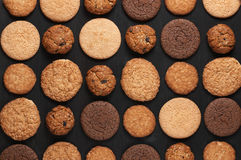 Various cookies on black Royalty Free Stock Photography