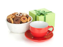 Various cookies, red tea cup and green gift box Stock Photos