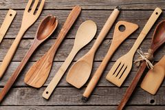Various cooking utensils. Over wooden kitchen table. Top view Royalty Free Stock Images
