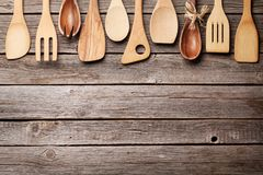 Various cooking utensils. Over wooden kitchen table. Top view with space for your recipe Stock Images