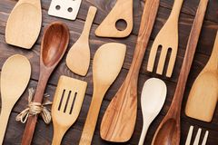 Various cooking utensils. Over wooden kitchen table. Top view Stock Images