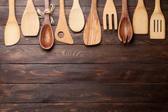 Various cooking utensils. Over wooden kitchen table. Top view with space for your recipe Royalty Free Stock Images