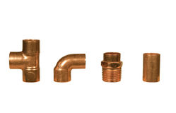 Various copper plumbing fittings. Four different copper fittings isolated with clipping paths at this size Stock Photo