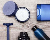 Various cosmetic products for men. Cosmetics for men. Set of various cosmetic products for men on shabby wooden surface Royalty Free Stock Photo