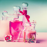 Various cosmetic skin , hairs and body care products in bottles on pink turquoise blue background, front view, place for text, sq Royalty Free Stock Photos