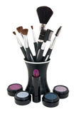 Various cosmetics with application brushes Royalty Free Stock Photos